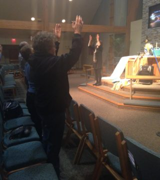 BlkD Worship Lifting Hands to God side view